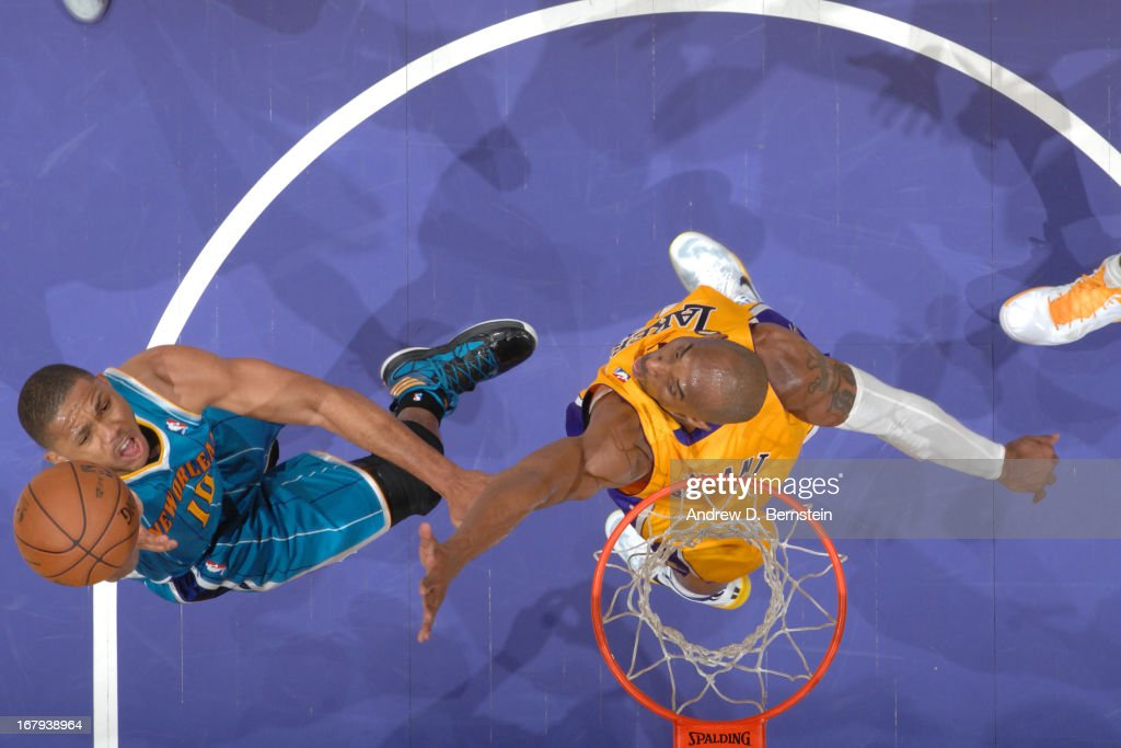 Eric Gordon #10 of the New Orleans Hornets goes up for the layup against Kobe Bryant #24 of the Los Angeles Lakers at Staples Center on April 9, 2013 in Los Angeles, California.