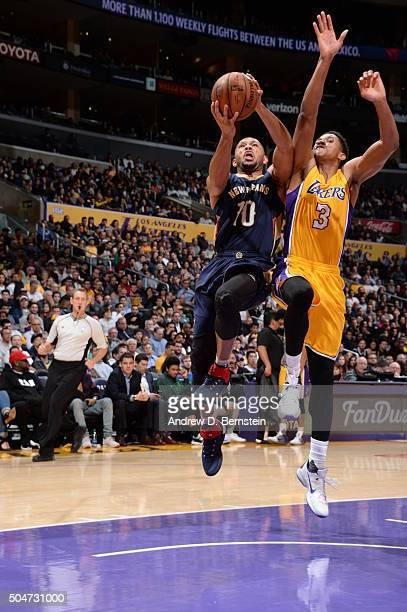 Eric Gordon of the New Orleans Pelicans goes to the basket against Anthony Brown of the Los Angeles Lakers on January 12 2016 at STAPLES Center in...