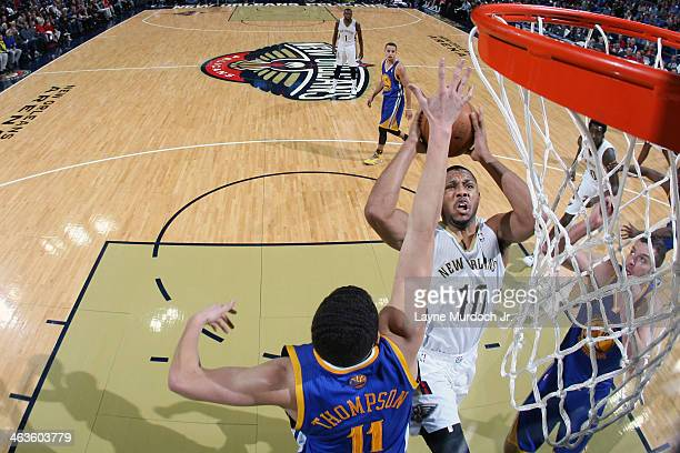 Eric Gordon of the New Orleans Pelicans goes up for the layup against the Golden State Warriors during an NBA game on January 18 2014 at the New...