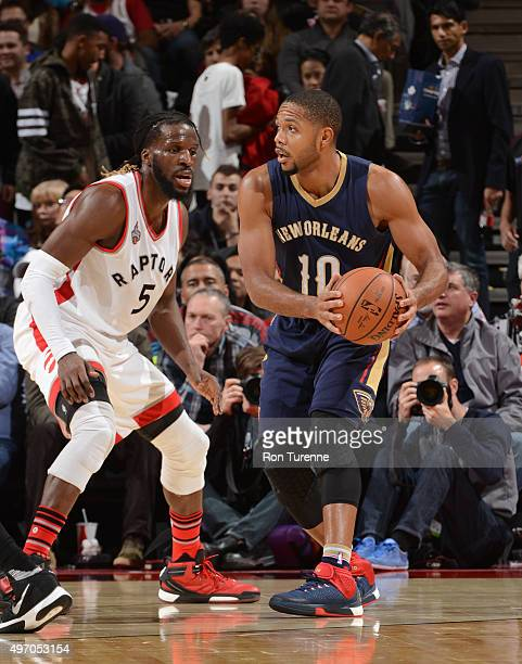 Eric Gordon of the New Orleans Pelicans handles the ball against DeMarre Carroll of the Toronto Raptors on November 13 2015 at the Air Canada Centre...