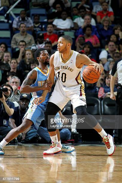 Eric Gordon of the New Orleans Pelicans handles the ball against the Denver Nuggets on March 10 2014 at the Smoothie King Center in New Orleans...
