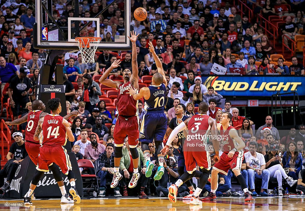 Eric Gordon #10 of the New Orleans Pelicans shoots as Chris Bosh #1 of the Miami Heat defends during the second half of the game at American Airlines Arena on December 25, 2015 in Miami, Florida.