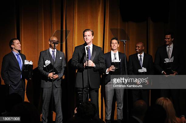 Eric Greitens, Tim King, Willie Geist, Laren Poole, Deogratias Niyizonkiza and Jake Wood pose onstage at GQ's Gentlemen's Ball Presented By Gentleman...