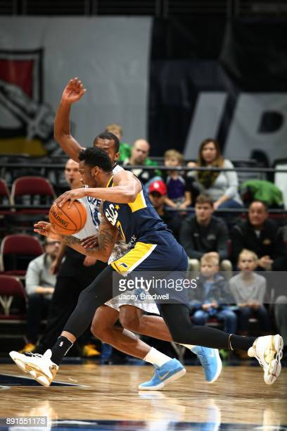 Eric Griffin of the Salt Lake City Stars drives around Elijah Millsap of the Iowa Wolves in an NBA GLeague game on December 8 2017 at the Wells Fargo...