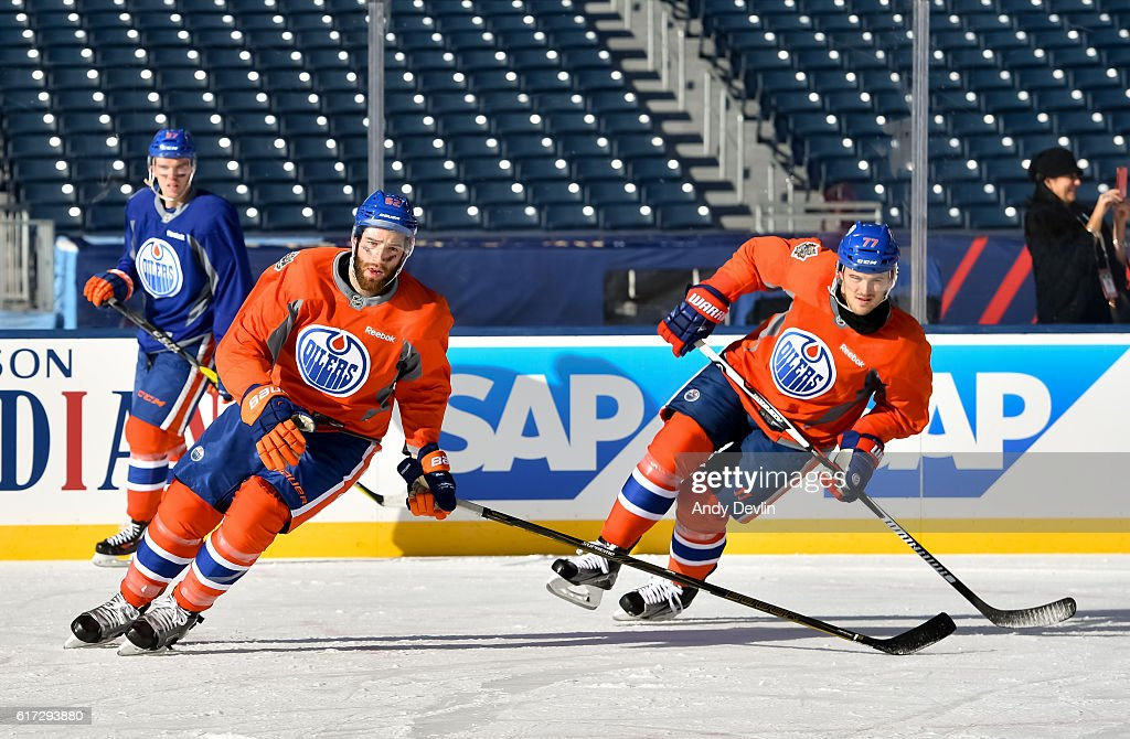 Eric Gryba #62 and Oscar Klefbom #77 of the Edmonton Oilers skate during warmup in advance of the 2016 Tim Hortons NHL Heritage Classic game at Investors Group Field on October 22, 2016 in Winnipeg, Canada.