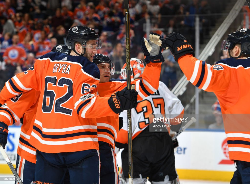 Eric Gryba #62, Michael Cammalleri #13 and Patrick Maroon #91 of the Edmonton Oilers celebrate after a goal during the game against the Philadelphia Flyers on December 6, 2017 at Rogers Place in Edmonton, Alberta, Canada.
