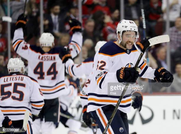 Eric Gryba of the Edmonton Oilers and the rest of the bench celebrates teammate Leon Draisaitl's game winning goal in overtime against the New Jersey...