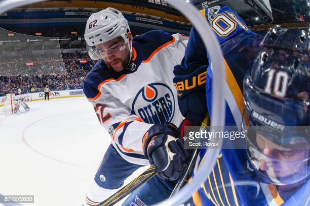 Eric Gryba of the Edmonton Oilers checks Brayden Schenn of the St Louis Blues at Scottrade Center on November 21 2017 in St Louis Missouri