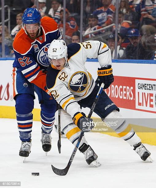 Eric Gryba of the Edmonton Oilers pursues Hudson Fasching of the Buffalo Sabres on October 16 2016 at Rogers Place in Edmonton Alberta Canada