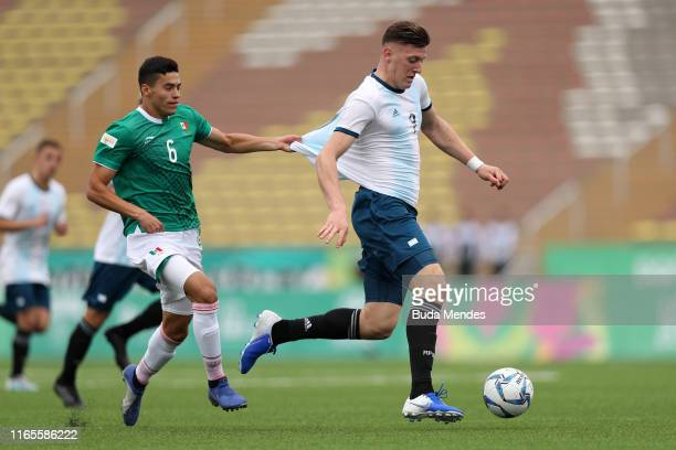 Eric Guerrero Cantu of Mexico tries to stop Adolfo Gaich of Argentina during Men´s football First Round Group A match between Mexico and Argentina on...