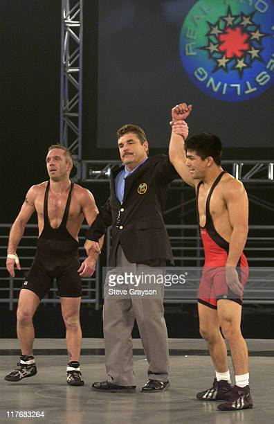 Eric Guerrero is declared the winner after defeating Eric Akin in the 60kg Freestyle Division
