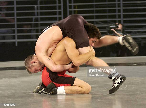 Eric Guerrero of the Red Team in action against Eric Akin of the Black Team in the 60kg Freestyle Division