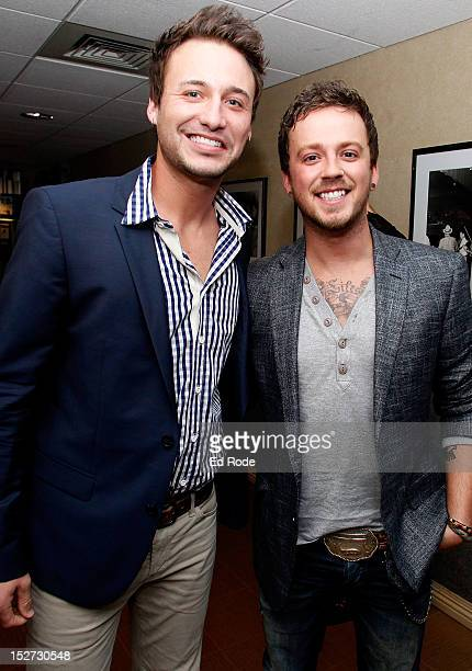 Eric Gunderson and Stephen Barker Liles of Love Theft are pictured backstage at the 6th Annual ACM Honors at Ryman Auditorium on September 24 2012 in...