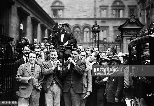 Eric H Liddell winner of the Olympic 400 Metres gold medal at the Paris games in 1924 is carried through the streets of Edinburgh after his...