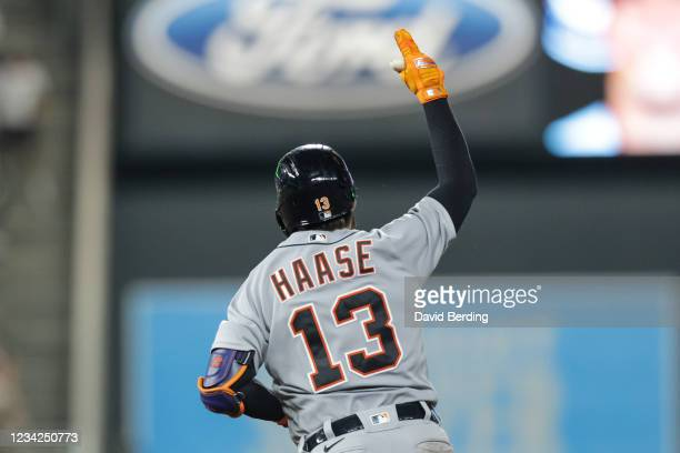 Eric Haase of the Detroit Tigers celebrates his grand slam as he rounds the bases in the ninth inning of the game against the Minnesota Twins at...