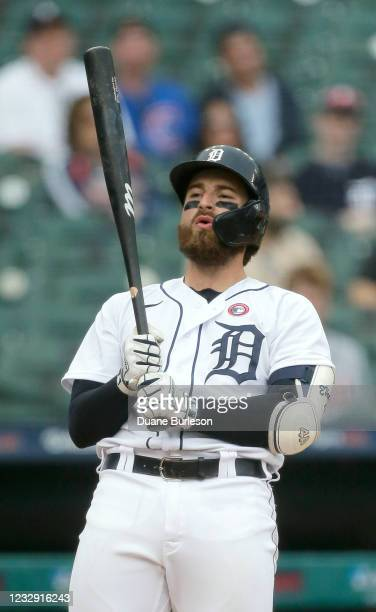 Eric Haase of the Detroit Tigers reacts after being called out on strikes during the seventh inning of a game against the Chicago Cubs at Comerica...