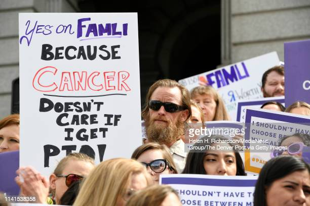 Eric Hale left with sunglasses and beard holds up a sign along with other supporters of Senate bill 19188 as they take part in a rally on the west...