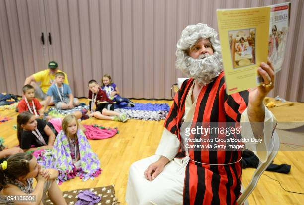 Eric Hanson dressed as Noah reads a chapter out of The Story of Ruby Bridges by Robert Coles during Camp Noah Thursday July 31 at the Church of Jesus...