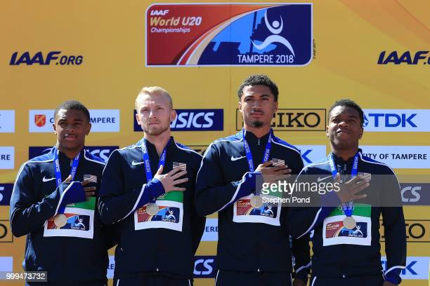 Eric Harrison Anthony Schwartz Austin Kratz and Micah Williams of The USA celebrate with their medals during the medal ceremony for the men's 4x100m...