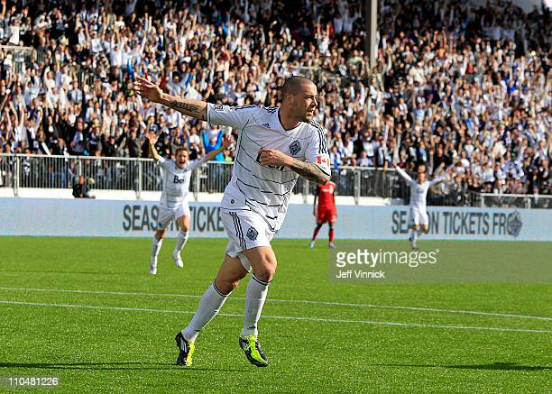 Eric Hassli of the Vancouver Whitecaps FC celebrates his goal and the Whitecaps first inaugural goal against the Toronto FC during their match March...