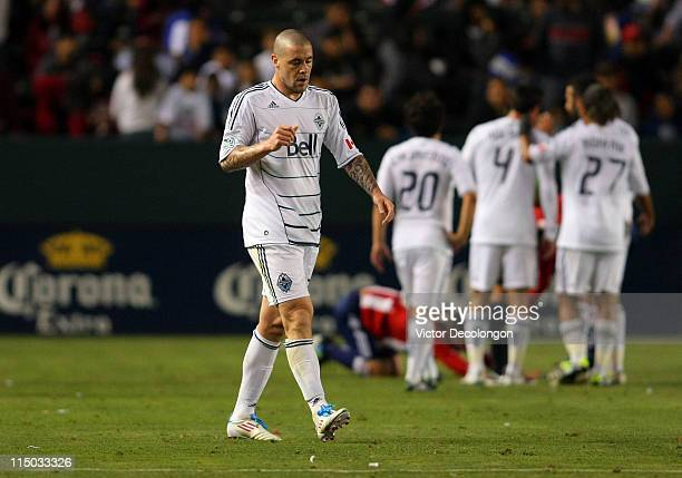 Eric Hassli of the Vancouver Whitecaps walks toward the locker room after receiving a red card for a hard foul on Ben Zemanski of Chivas USA in the...