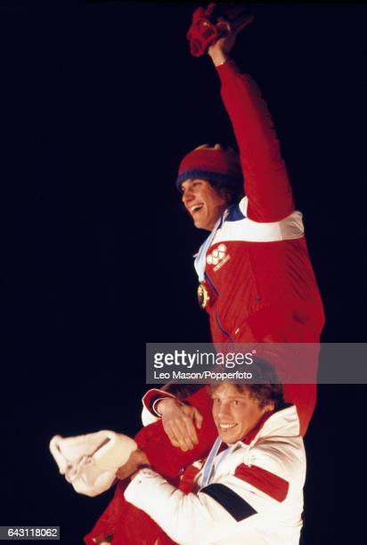 Eric Heiden of the USA celebrates winning the men's 10000 metres speed skating gold medal in World Record time during the Winter Olympic Games in...