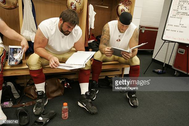 Eric Heitmann and Barry Sims of the San Francisco 49ers review plays in the locker room before the NFL game against the Chicago Bears at Soldier...