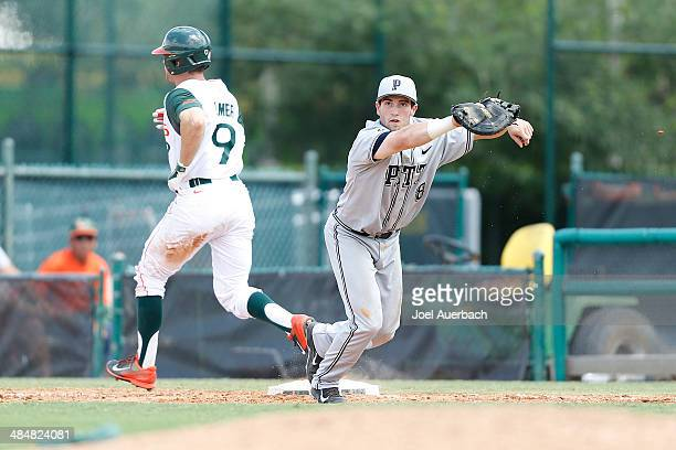 Eric Hess of the Pittsburgh Panthers gets Tyler Palmer of the Miami Hurricanes out at first for the final out of the seventh inning with bases loaded...