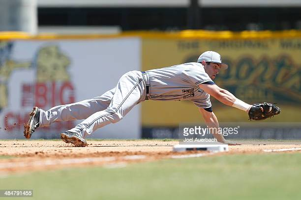 Eric Hess of the Pittsburgh Panthers makes a diving catch of the ball hit by Zack Collins of the Miami Hurricanes for the final out of the first...