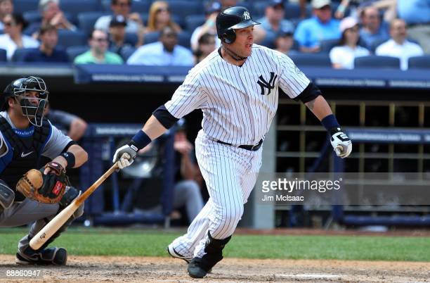 Eric Hinske of the New York Yankees follows through on a seventh inning single against the Toronto Blue Jays on July 6, 2009 at Yankee Stadium in the...