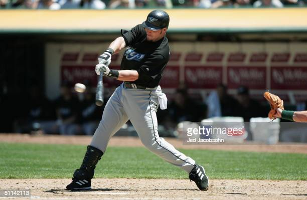 Eric Hinske of the Toronto Blue Jays swings at the pitch during the game against the Oakland Athletics at the Network Associates Coliseum on July 20...