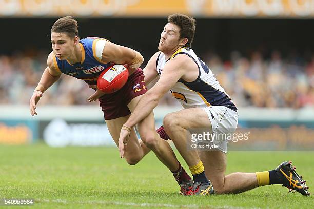 Eric Hipwood of the Lions and Jeremy McGovern of the Eagles compete for the ball during the round 13 AFL match between the Brisbane Lions and the...