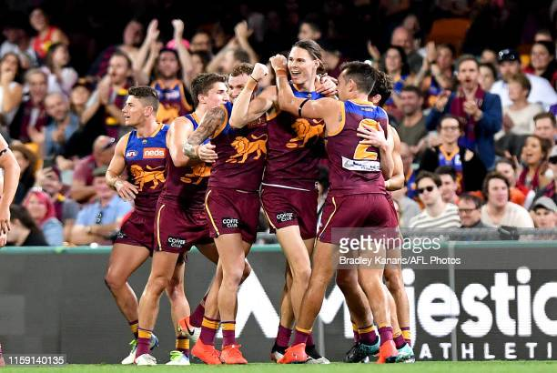 Eric Hipwood of the Lions celebrates kicking a goal during the round 15 AFL match between the Brisbane Lions and the Melbourne Demons at The Gabba on...