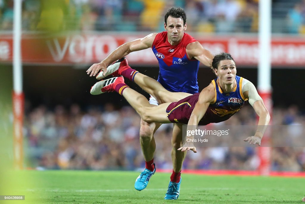 Eric Hipwood of the Lions handballs during the round two AFL match between the Brisbane Lions and the Melbourne Demons at The Gabba on March 31, 2018 in Brisbane, Australia.
