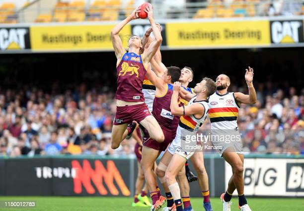 Eric Hipwood of the Lions takes a mark during the round nine AFL match between the Brisbane Lions and the Adelaide Crows at The Gabba on May 18, 2019...