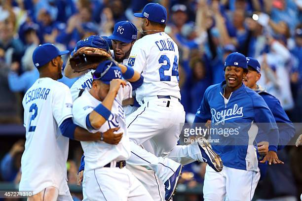 Eric Hosmer Alcides Escobar Christian Colon and Mike Moustakas of the Kansas City Royals celebrate their 2 to 1 win over the Baltimore Orioles to...
