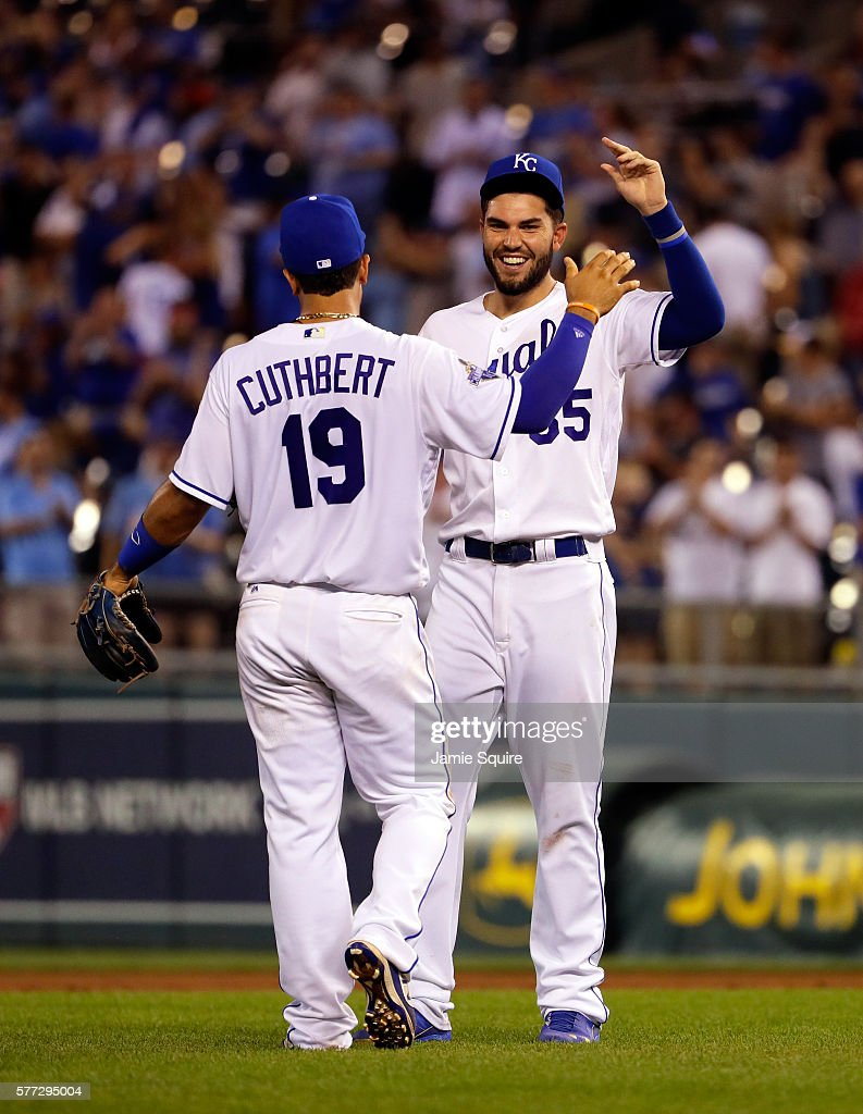 Eric Hosmer #35 and Cheslor Cuthbert #19 of the Kansas City Royals celebrate as the Royals defeat the Cleveland Indians 7-3-to win the game against the Cleveland Indians at Kauffman Stadium on July 18, 2016 in Kansas City, Missouri.