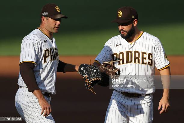 Eric Hosmer, and congratulates Craig Stammen of the San Diego Padres after being pulled during the second inning of Game Three of the National League...