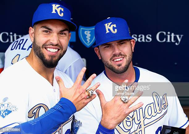 Eric Hosmer and Mike Moustakas of the Kansas City Royals pose with their World Series Championship rings after a ring ceremony prior to the game...