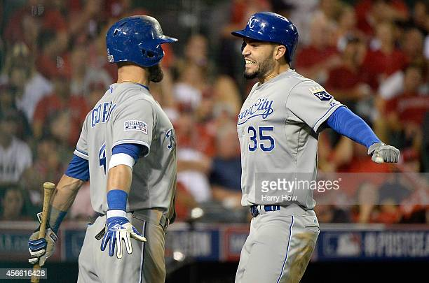 Eric Hosmer celebrates with Alex Gordon of the Kansas City Royals after hitting a tworun home run in the elventh inning against the Los Angeles...