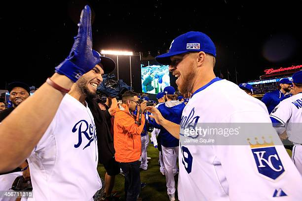 Eric Hosmer celebrates with Erik Kratz of the Kansas City Royals on the field after defeating the Los Angeles Angels 83 in Game Three of the American...