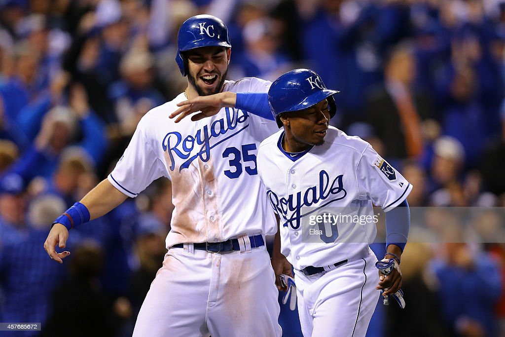 Eric Hosmer #35 celebrates with Terrance Gore #0 of the Kansas City Royals after scoring in the sixth inning against the San Francisco Giants during Game Two of the 2014 World Series at Kauffman Stadium on October 22, 2014 in Kansas City, Missouri.