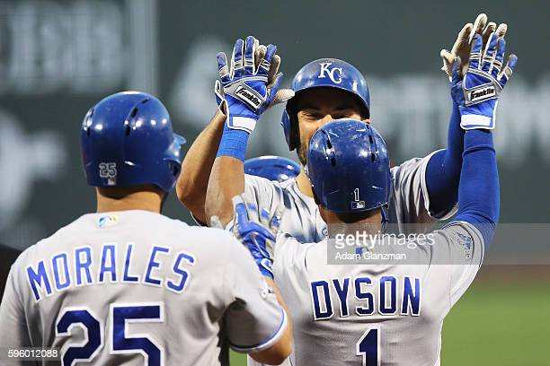 Eric Hosmer high fives Jarrod Dyson of the Kansas City Royals after hitting a threerun home run in the first inning during a game against the Boston...