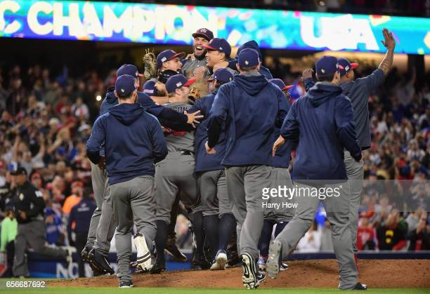 Eric Hosmer of team United States who made the final out in the ninth inning celebrates with teammates after their 80 win against previously...