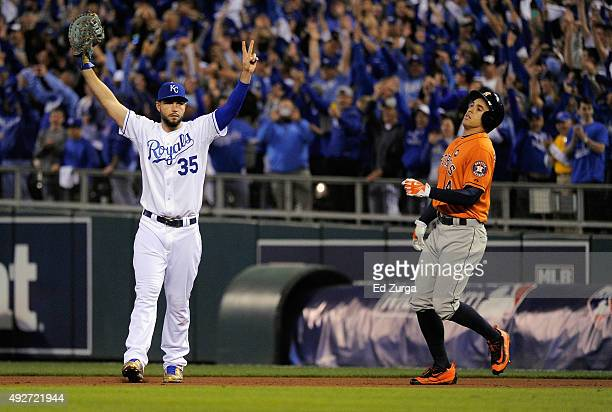 Eric Hosmer of the Kansas City Royals and George Springer of the Houston Astros react after the Kansas City Royals defeat the Houston Astros 72 in...