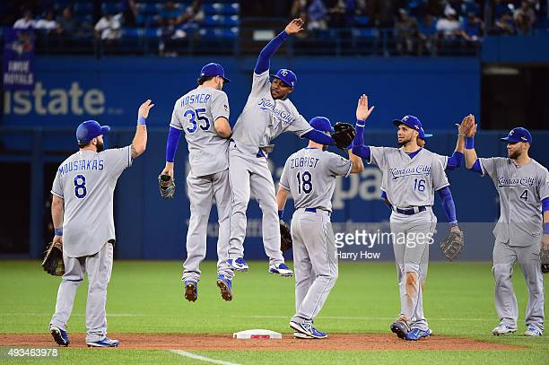 Eric Hosmer of the Kansas City Royals and Jarrod Dyson of the Kansas City Royals celebrate defeating the Toronto Blue Jays 14-2 in game four of the...