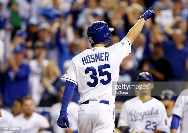 Eric Hosmer of the Kansas City Royals celebrates after hitting a home run in the third inning against the Los Angeles Angels during Game Three of the...
