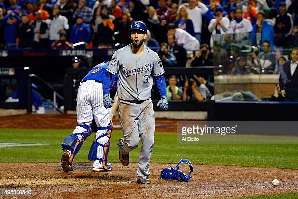 Eric Hosmer of the Kansas City Royals celebrates after scoring a run off of a grounded out hit by Salvador Perez to tie the game in the ninth inning...