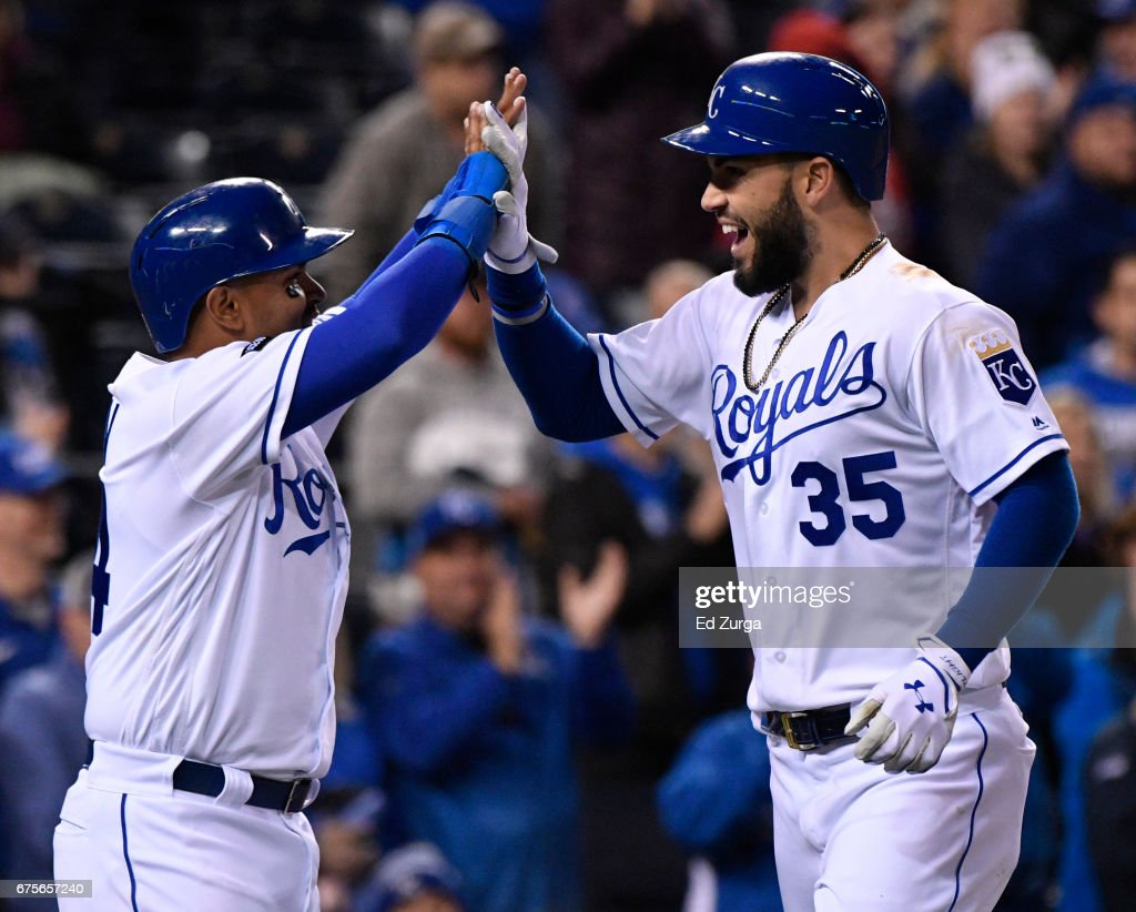 Eric Hosmer #35 of the Kansas City Royals celebrates his two-run home run with Christian Colon #24 in the seventh inning against the Chicago White Sox at Kauffman Stadium on May 1, 2017 in Kansas City, Missouri.