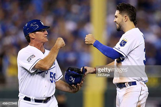 Eric Hosmer of the Kansas City Royals celebrates with third base coach Mike Jirschele in the third inning against the Oakland Athletics during the...